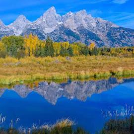 by Scott Fishman - Landscapes Mountains & Hills ( bison, elk, rivers, landscape, grand tetons, yellowstone, barn, steampots, sunset, jeff pedersen, fall, mobile home, aspens, sunrise, rv )