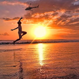 jump and catch by Malik Artan - Digital Art People