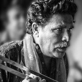 Music is in thy soul by Maha Khan - People Street & Candids ( music, pakistan, black and white, candid, people, portrait )