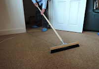 carpet rake being used in reading