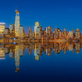 Lower Manhattan skyline at night reflected in water by Jan Gorzynik - City,  Street & Park  Night ( famous, skyline, reflection, harbor, lower, america, metropolis, metropolitan, empire, state, apartment, travel, nyc, cityscape, architecture, ny, usa, business, hudson, city, modern, sky, skyscraper, york, east, light, evening, downtown, financial, water, building, twilight, manhattan, tourism, scenic, dusk, urban, landmark, new, blue, scene, night, view, waterfront, river )