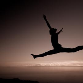 Just do it... by Ronen Rosenblatt - Sports & Fitness Other Sports ( desert, girl, jumping, silluette )