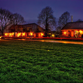 Diner I by Raymon Brugman - City,  Street & Park  Vistas ( panorama long exposure night country fields meadows grass country night camera trees horizon lighttrails tracers reflection contemplation mood surreal feelings beautifull nature clouds clouded cloudy rainy rain raining village people lights )