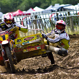 Hold on tight.... by Mike Ross - Sports & Fitness Motorsports ( mud, motocross, mike ross, milton malsor, hanging on, sidecars, mx, acu )