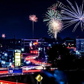 Night Lights by Jim Harris - Public Holidays July 4th ( road, night, highway at night, city lights, fireworks, highway, city at night, lights )