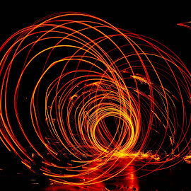 Through The Worm Hole by Brenda Hooper - Abstract Fire & Fireworks ( orange, steel wool, fireworks, worm hole, yellow, fire, black, hole,  )