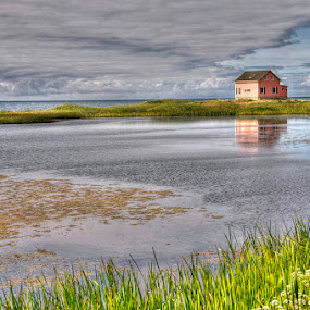 pink house magdeleine islands by Evelyn Young - Landscapes Travel