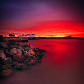 Bloody terminal by Ruslan Bolgov - Landscapes Sunsets & Sunrises ( water, port, vessel, red, terminal, sunset, klaipeda, long exposure, lithuania, stones )