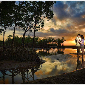love and affection at sunrise by Rolando Pascua - People Couples