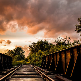 Rustic Sunset by Eric Anderson - Landscapes Sunsets & Sunrises ( clouds, sunset, railroad, train, bridge )