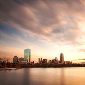 Boston Skyline by Josh Balduf - City,  Street & Park  Vistas ( clouds, water, skyline, boats, charles, streak, boston, blue, sunset, buildings, pier, gold, motion, river )