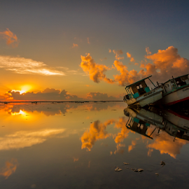 Morning Reflection by Choky Ochtavian Watulingas - Landscapes Waterscapes ( clouds, boats, sun light, seascape, sunrise, morning, sun, skies, golden hour )