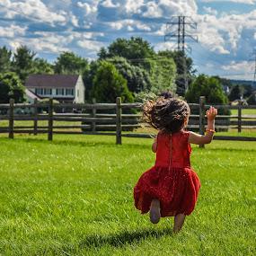 Running Away by Tiffany Serijna - Babies & Children Children Candids ( grass, sports, little, fun, pretty, running, photo, field, child, girl, red, dress, action, toddler, outside,  )