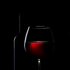 Wine in low light by Dumitru Doru - Food & Drink Alcohol & Drinks ( wine, red, shadow, glass, low light, light, bootle, closeup, black )