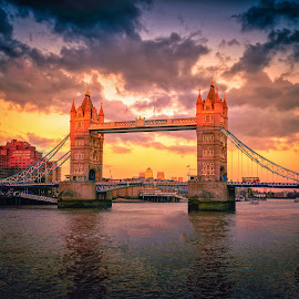 Tower Bridge landmark in London city at sunset in UK. by Nuttawut Uttamaharach - Buildings & Architecture Bridges & Suspended Structures ( symbol, capital, britain, london, city, iconic, bright, british, clouds, monument, skyline, summer, tourist, beautiful, white, uk, thames, national, landmark, day, architecture, tower, sky, england, famous, history, great, kingdom, water, morning, stone, touristic, transportation, sunlight, attraction, blue, urban, granite, bridge, river, drawbridge )