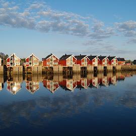 Perfect mirror by Ester Ayerdi - City,  Street & Park  Vistas ( water, clouds, reflection, houses, sea, reflections, landscape, norway, mirrored reflections, red, noruega, lofoten islands, view, red hourses, norge, lofoten,  )