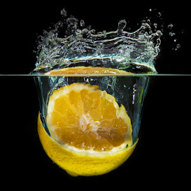 citron splash by Christoph Reiter - Food & Drink Fruits & Vegetables ( black background, water, citrion, splash, yellow, light )
