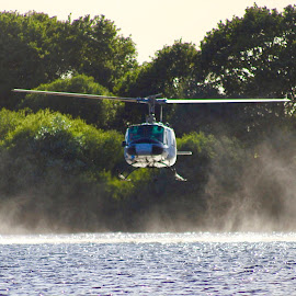 Tackling the fire by Brian Egerton - Transportation Helicopters ( helicopter, firefighter, water )