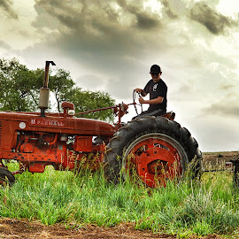 A Boy and his tractor by Jenny Batt - Transportation Other ( hdr, boy, rustic, tractor, rain, farming )