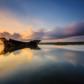 Morning Wreck by Choky Ochtavian Watulingas - Landscapes Waterscapes ( clouds, seashore, shipwrecks, clouds and sea, reflections, sunrise, seascape, morning, skies )