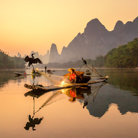 Fisherman by Indrawaty Arifin - People Professional People ( hills, cormorant, morning, fisherman, river,  )