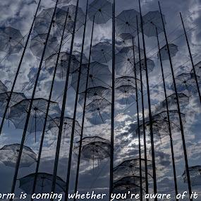 Umbrellas by Stratos Lales - Typography Quotes & Sentences ( sky, umbrella, cloud, storm, sun )