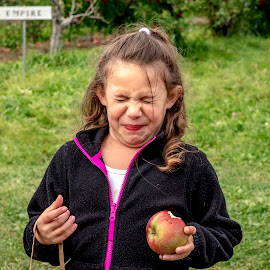 Sour Apple = Pucker Face by Debbie Quick - Babies & Children Children Candids ( apple picking, debbie quick, young, pucker face, outdoor photography, kid, apple orchard, girl, debs creative images, apple, sour apple, outdoors, orchard, candid, vermont, family, child )