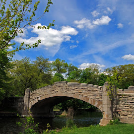 Bridge and Sky by Judy Florio - Buildings & Architecture Bridges & Suspended Structures ( clouds, water, sky, park, trees, stone, lake, bridge, spring )
