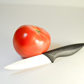 Tomato and Knife  by Sawyer Jones Photography  - Artistic Objects Cups, Plates & Utensils ( studio, blank background, flash, red, product photography, stock, 35mm., tomato, continuous lighting, white, nikon d7000, knife )