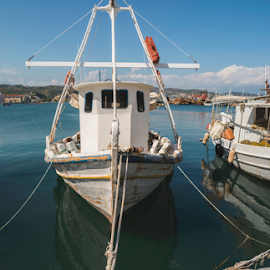 Fishing boats in Greece. by Deyan Georgiev - Transportation Boats ( port, trawler, old, europe, harbor, fishing-boat, fish, ship, harbour, catch, ocean, transportation, net, dock, coast, sky, nature, transport, industry, commercial, water, clouds, marine, fishery, vessel, boats, white, sea, traditional, boat, coastal, vacation, wooden, blue, bay, outdoors, summer, fishing, fisherman, small, nautical )