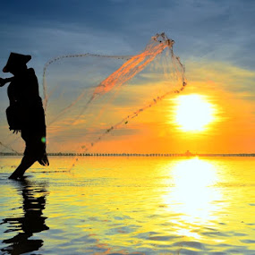 Fisherman in Action by Agus Devayana - Landscapes Sunsets & Sunrises