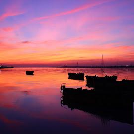 Dreamland by Pinkesh Modi - Landscapes Sunsets & Sunrises ( clouds, orange, dreamy, skyline, dream, colorful, colors, silhouette, yellow, landscape, boat, colours, colour, red, sky, blue, color, cloud, silhouettes, pink, landscapes )