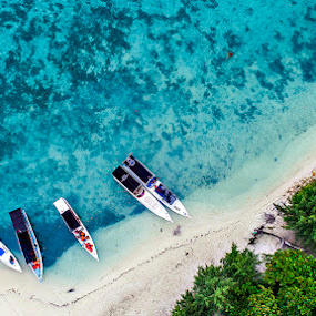 Boats on the beach by Robby Kurnia - Transportation Boats