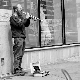 No Customers by Barbara Brock - People Musicians & Entertainers ( black and white street scene, man on the street, man playing trumpet, musician in the street, urban street scene,  )