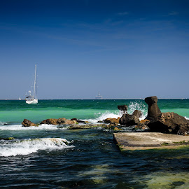 Eforie Nord by Tofan Dani - Landscapes Weather ( europe, sky, nature, blue, colors, weather, romania, beach, east, travel, places, boat, rocks )