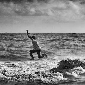 Jump !! by Vatsal Patel - People Street & Candids ( water, sony, blackandwhite, sea, india, candid, beach, arabian, people, rocks, portrait, jump )