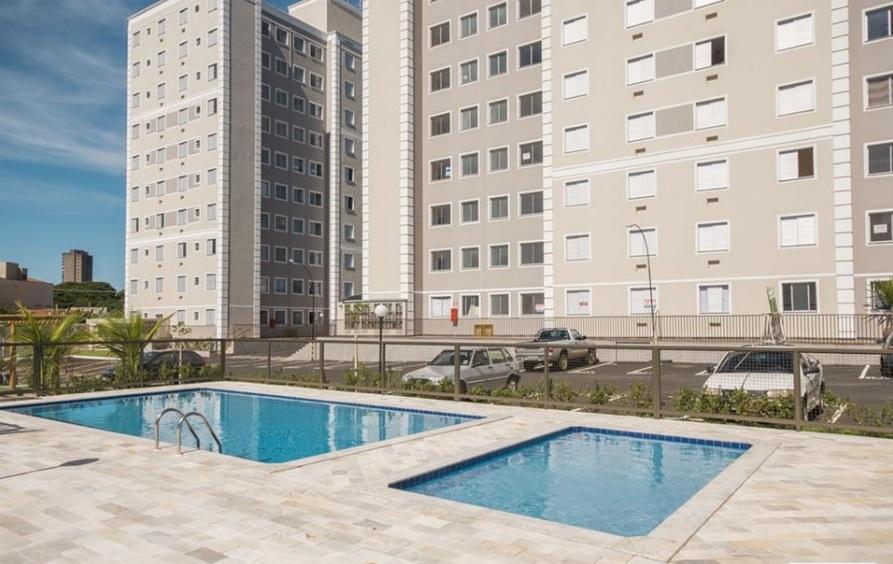 Apartamento em localização nobre com 48m² 2 quartos com armários, sala cozinha americana, banheiro social, área de serviço, 1 vaga de garagem.
