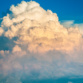 Angry Skies by Myra Brizendine Wilson - Landscapes Cloud Formations ( clouds, clouds from airplane, clouds in blue sky, sunset skies, sunset, sunset in clouds, sunset from plane )
