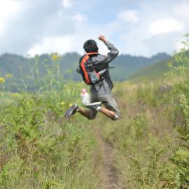 let's touch the scattering sky by Rangga Bhirawa - People Portraits of Men ( teletubbies, indonesian, malang, indonesia, probolinggo, lumajang, bagus, landscape, bromo, people, surabaya, jump )