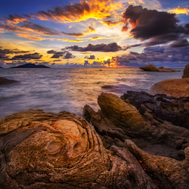 In the crevice between rocky beach by Dany Fachry - Landscapes Beaches