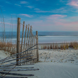 Still Standing by Chuck Lawhon - Landscapes Beaches ( clouds, sand, fence, long exposure, beach )
