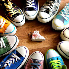 In the middle by Janine Kain - Artistic Objects Clothing & Accessories ( shoes, fashion, footwear, worn, hi-tops, material, colours, lo-tops, laces, style, converse, trainers, fabric )