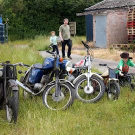 Family motorbikes by Caroline Beaumont - People Family ( dad, bike, motorcycle, son, helmet )