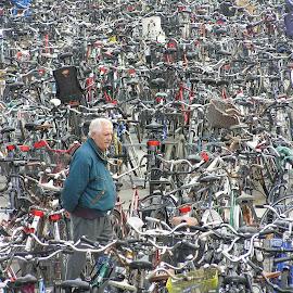 No, I am not looking for my bike. I just like to bee here.  by Staffan Håkansson - People Street & Candids ( looking, parking, sweden, malmoe, bike, scania, men )