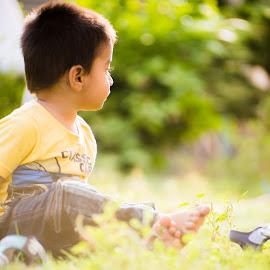 baby in garden by Syed Nayyar Hussain Kazmi - Babies & Children Babies ( green, highlights, light, sony alpha, baby, bokeh, garden,  )