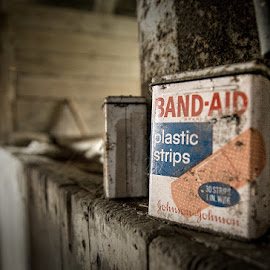 Band-Aids In The Barn by T Sco - Artistic Objects Still Life ( farm, bandaid, wood, adhesive, barn, first aid, band-aid, container, tin, health, rural )