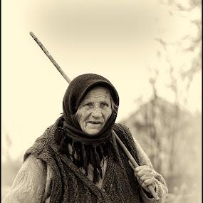 Lonly woman by Julien Oncete - People Portraits of Women ( b&w, stick, woman, street, house )