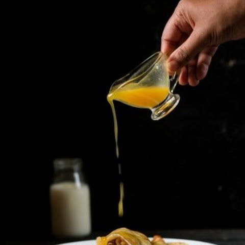Crepes Filled With Apples & Topped With Orange Sauce