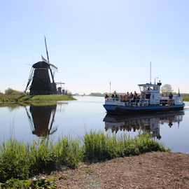 Morning in Holland  by Stephanie Veronique - Transportation Boats ( rivers, windmill, tourism, boat, landscape, tour, morning, transportation )