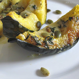 Cheesy Thyme Baked Acorn Squash with Toasted Pumpkin Seeds {#SundaySupper}